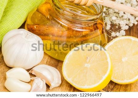 Honey,garlic and lemon.  Natural medicine - stock photo