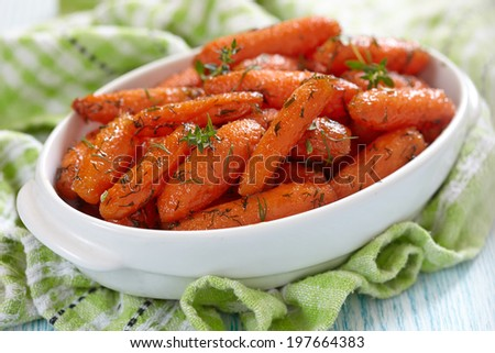 Honey Glazed Baby Carrots With Thyme And Dill - stock photo