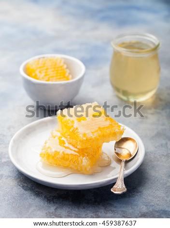 Honey, honeycombs on a grey stone background - stock photo