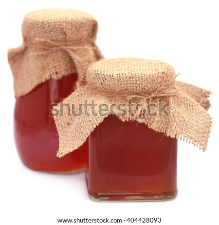 Honey in glass jar over white background - stock photo