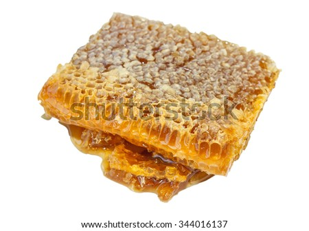 Honey in honeycomb isolated on white background - stock photo
