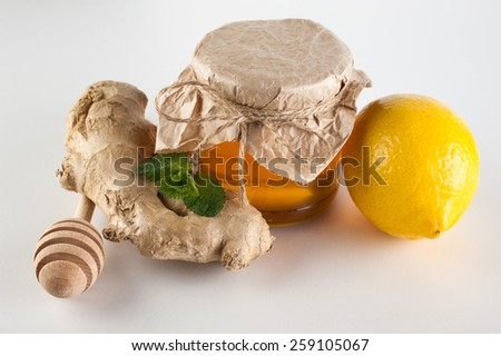 honey in jar , mint,  lemon and ginger  on a white background - stock photo