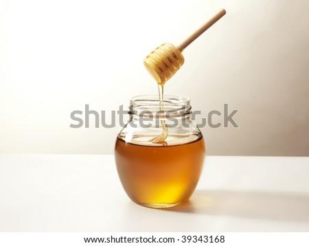 honey on a stick - stock photo