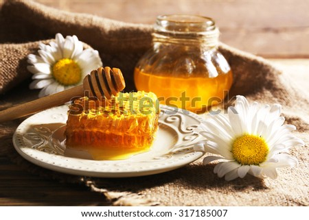 Honey products on wooden table - stock photo
