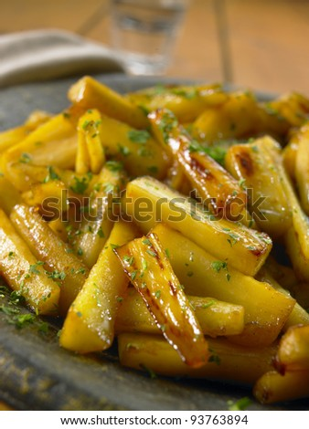 Honey Roast Parsnips with a Sprinkling of Herbs - stock photo