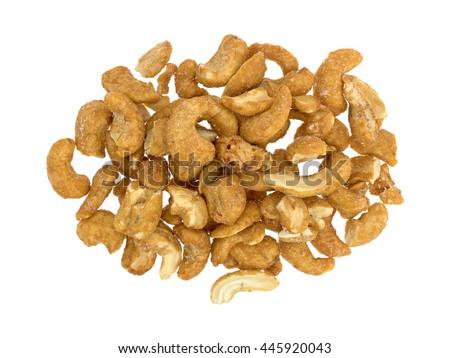 Honey roasted cashews isolated on a white background. - stock photo