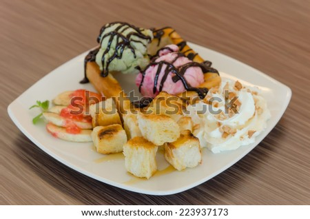Honey toast and whipping cream with chocolate  sauce and ice cream - stock photo