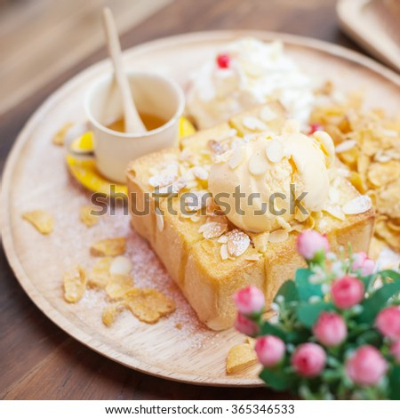 Honey Toast, Consists of bread topped with honey and ice cream - stock photo