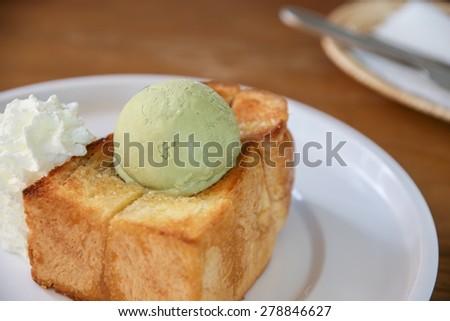 honey toast with green tea ice cream and whipped cream - stock photo