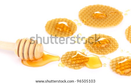 Honeycomb and honey isolated on white - stock photo