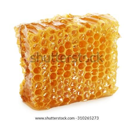 Honeycomb isolated on white - stock photo