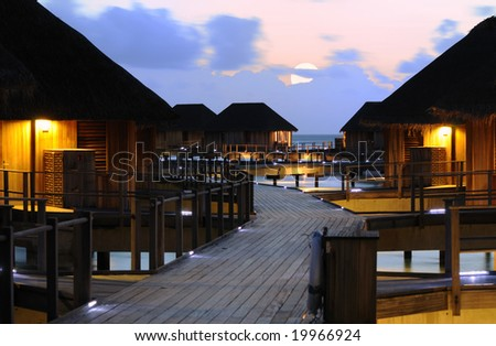 Honeymoon Resort - Beautiful Night of Water Villa on the Beach - stock photo