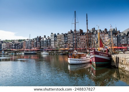 HONFLEUR, NORMANDY, FRANCE - AUGUST 23: View to the harbour of Honfleur, France on August 23, 2014. It is located on the southern bank of the estuary of the Seine across from le Havre. - stock photo