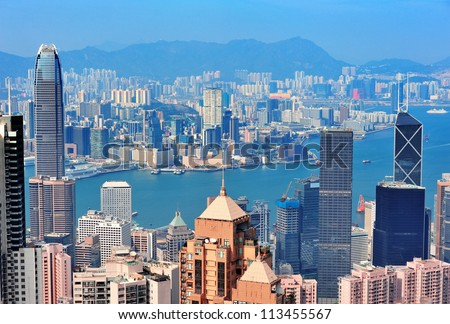 Hong Kong aerial view panorama with urban skyscrapers and sea. - stock photo