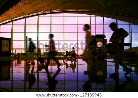 Hong Kong airport, travelers walking - stock photo