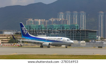 HONG KONG - APR 30, 2015: All Nippon Airways flight in Hong Kong International Airport. About 90 airlines operate flights from HKIA to over 150 cities across the globe. - stock photo