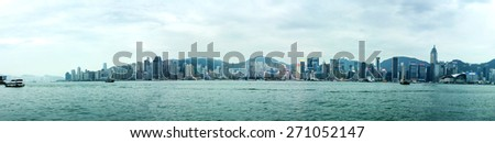 HONG KONG - APR 20, 2015: Panorama of Hong Kong skyline. With a population of 7 million people, Hong Kong is one of the most densely populated areas in the world - stock photo