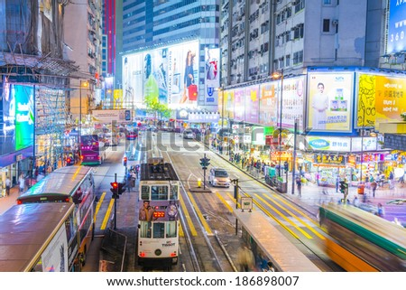 HONG KONG,  - 07 APR : Street view with traffic and shops on April 07, 2014 in Hong Kong, China. With 7M population and land mass of 1104  km, it is one of the most dense areas in the world. - stock photo