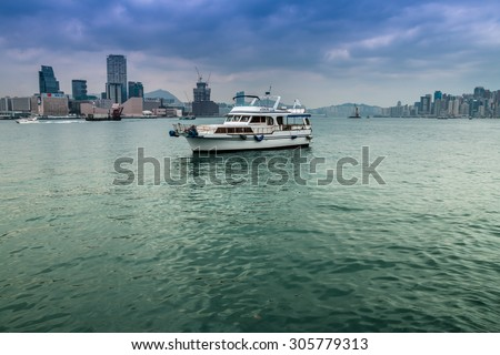 HONG KONG - APR 12: Victoria Harbour on Apr 12, 2015. Victoria Harbour is a famous tourist attractions in Hong Kong. - stock photo