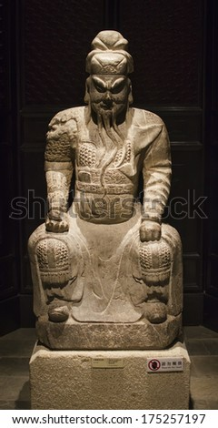 Hong Kong - 12 April: large sitting stone guardian April 12, 2013 in Hong Kong, China. A large statue guards located in the museum of the city of Hong Kong. - stock photo