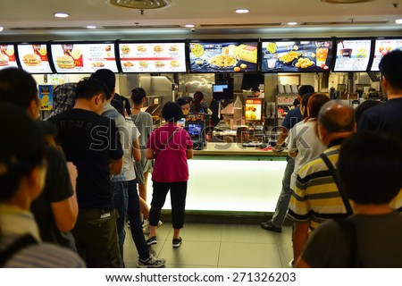 HONG KONG - APRIL 03, 2015: McDonald's restaurant interior. The McDonald's Corporation is the world's largest chain of hamburger fast food restaurants, serving around 68 million customers daily - stock photo