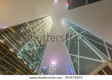 HONG KONG - APRIL 4, 2014: Modern skyline of Hong Kong at night. The city attracts more than 30 million people annually. - stock photo