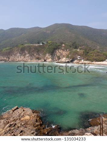 "HONG KONG - APRIL 10: Tai Long Wan beach ""Big Wave Bay"" in Hong Kong on April 10 2011. Considered one of the most beautiful places in Hong Kong, it is a popular surf destination. - stock photo"