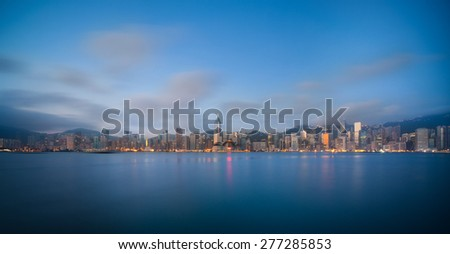 Hong Kong at night view from Kowloon side to Hong Kong island. - stock photo