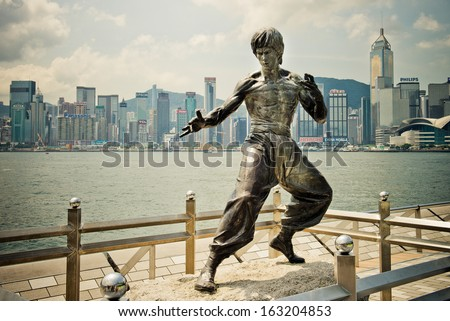 HONG KONG - AUGUST 29: Avenue of Stars. The Avenue of Stars, modelled on the Hollywood Walk of Fame, is located along the Victoria Harbour on August 29, 2013 in Hong Kong. - stock photo