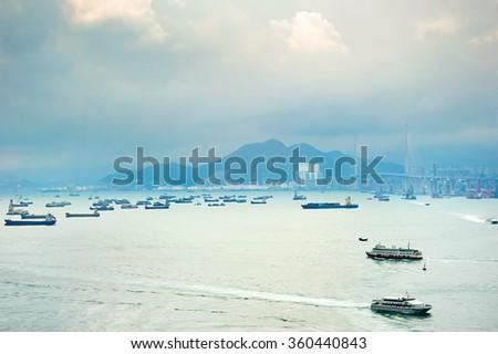 Hong Kong bay with a lot of ships. Tsing Ma bridge on the right. - stock photo