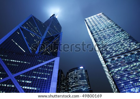 Hong Kong Business District at Night. Contemporary office buildings in Hong Kong at night. - stock photo