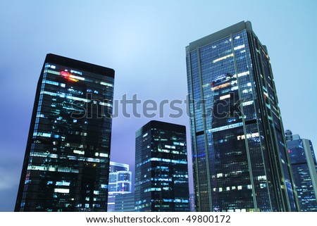 Hong Kong Business District at Night. Group of contemporary corporate buildings in Central of Hong Kong. - stock photo