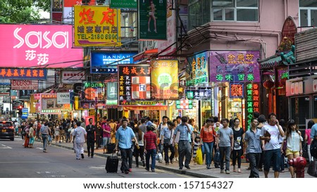 HONG KONG, CHINA - APR 23: Crowded street view at night on April 23, 2013 in Hong Kong, China. With 7M population and land mass of 1104 sq km, it is one of the most dense areas in the world.  - stock photo