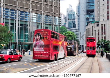 HONG KONG, CHINA - APR 23: Double-deck bus with skyscrapers on April 23, 2012 in Hong Kong, China. The Double-deck trams system in Hong Kong is one of three and the most famous in the world. - stock photo