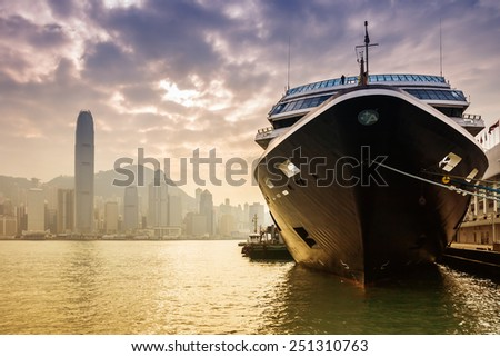 HONG KONG, CHINA - DEC 9: Big Cruise Ship berth at Victoria Harbor on December 9, 2013 in Hong Kong, China. Hongkong is a major tourist city in Asia,More than 40000000 visitors a year - stock photo