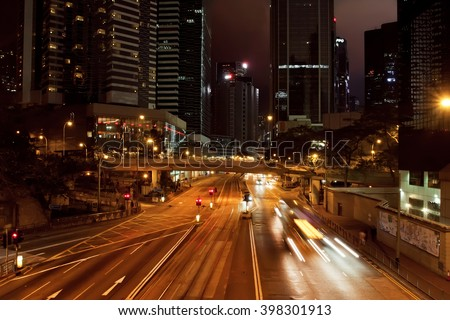HONG KONG, CHINA - FEB 10: Night bridge with lanterns, ?ark streets with hotels, skyscrapers on February 10, 2016. Hong Kong dollar is the eighth most traded currency in the world. - stock photo