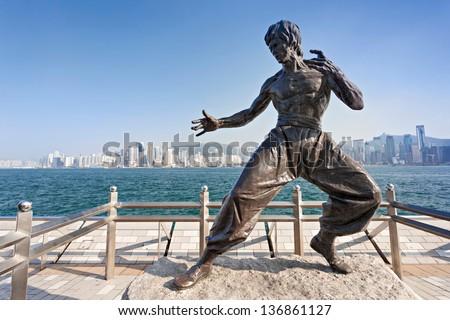 HONG KONG, CHINA - FEBRUARY 21: Bruce Lee statue at the Avenue of Stars on February, 21, 2013, Hong Kong, China. - stock photo