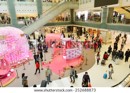 HONG KONG, CHINA - FEBRUARY 04, 2015: shopping center interior before Chinese New Year. In Hong Kong a wide selection of clothing boutiques, designer flagship stores, restauranta and etc - stock photo