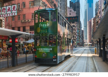 HONG KONG, CHINA - 18 JAN 2015: Electric trolleys and motor vehicles on a typical downtown street in Hong Kong, China. - stock photo