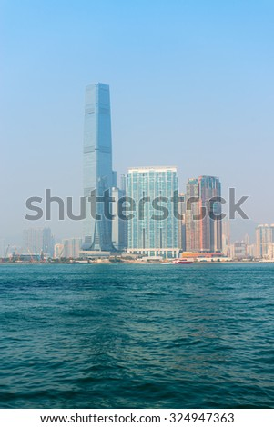HONG KONG, CHINA - 18 JAN 2015: International Commerce Center, the tallest building in Hong Kong, China, towers over the bay on a hazy day. - stock photo