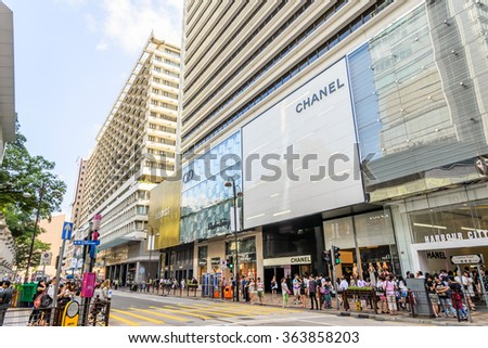 HONG KONG, CHINA - JUN 4 2015 : Canton Road, Tsim Sha Tsui is a luxury brands shopping street in Hong Kong. Hermes, Salvatore Ferragamo and Chanel are opened the flagship stores at Canton Road. - stock photo