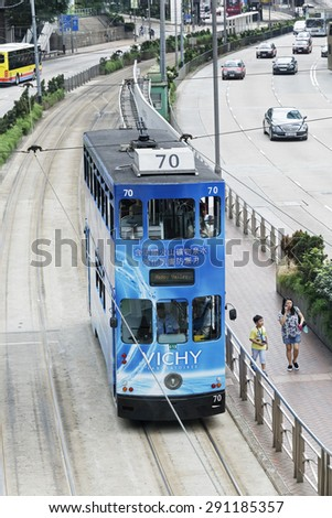 Hong Kong, China, June, 13, 2015 Double decker trams are a favorite means of transpotation for both tourist and locals alike in the city of Hong Kong - stock photo