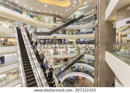 Hong Kong, China - June 7, 2015: People in a shopping mall in Hong Kong - stock photo