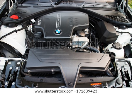 Hong Kong, China March 20, 2014 : BMW 220i 2014 Sedan engine on March 20 2014 in Hong Kong. - stock photo