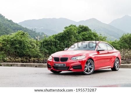 Hong Kong, China May 15, 2014 : BMW M235i Test Drive on May 15 2014 in Hong Kong. - stock photo