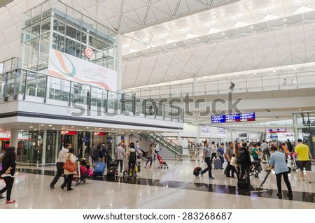 HONG KONG, CHINA - MAY 4: Passengers in the airport main lobby on MAY 4, 2015 in Hong Kong, China. The Hong Kong airport handles more than 70 million passengers per year. - stock photo