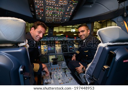 HONG KONG, CHINA - MAY 16, 2014: pilots in Emirates Airbus A380 aircraft after landing MAY 16, 2014. Emirates is the largest airline in the Middle East - stock photo