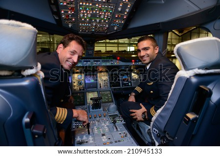 HONG KONG, CHINA - MAY 16, 2014: pilots in Emirates Airbus A380 aircraft after landing on May 16, 2014. Emirates is the largest airline in the Middle East - stock photo