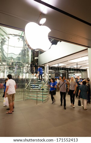 HONG KONG, CHINA - NOVEMBER 11, 2012: Buyers at the entrance at Apple store in Hong Kong. Store is in a shopping center IFC Mall, it is very popular with locals and tourists visiting Hong Kong. - stock photo