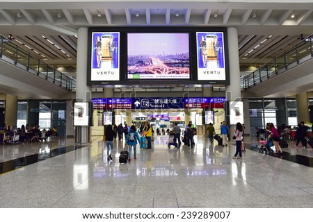 HONG KONG, CHINA - NOVEMBER 23: Passengers in the airport lobby on November 23, 2014 in Hong Kong, China.  - stock photo